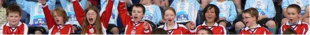Edinburgh shinty youth team members raise their arms in celebration