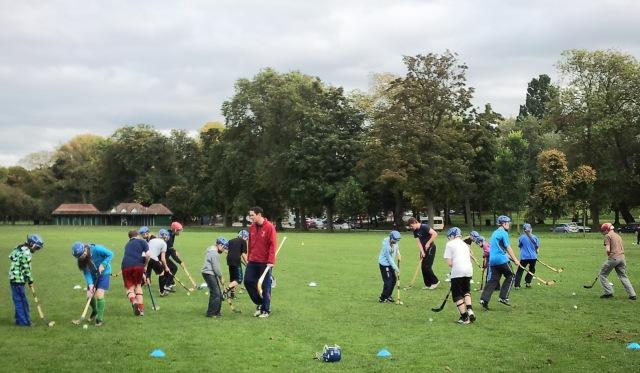 Ronald Ross puts some Camanachd Dhùn-Èideann kids through their paces on the Meadows